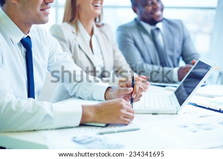Business people concentrated at the meeting - stock photo