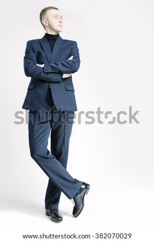 Business People Concepts and Ideas. Elegant Caucasian Businessman in Blue Suite. Vertical Image Composition - stock photo