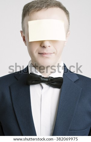 Business People Concepts And Ideas. Portrait of Caucasian Businessman With Paper Sticker on Forehead. Against White. Vertical Image - stock photo