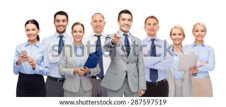 business, people, corporate, teamwork and office concept - group of happy businesspeople pointing at you - stock photo