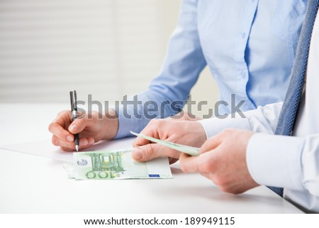 Business people counting banknotes - closeup shot of hands - stock photo