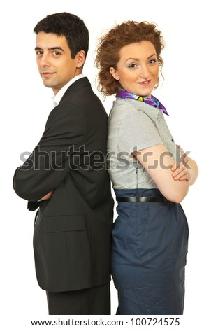 Business people couple woman and man standing back to back with arms folded isolated on white background - stock photo