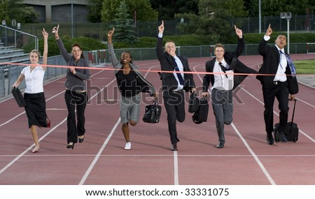 Business people cross the finish line