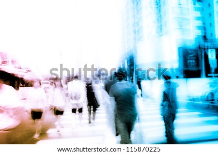 business people crowd in city street blur - stock photo