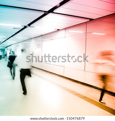 business people crowd walk at subway station abstract Blurred Motion - stock photo