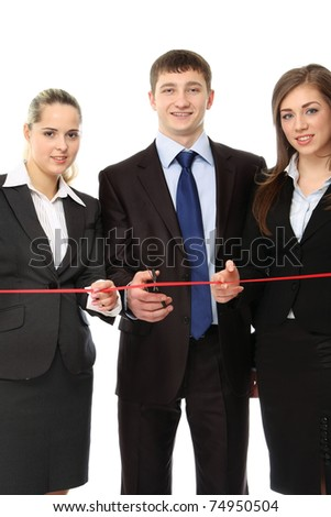 Business people cutting a red ribbon with a pair of scissors - stock photo