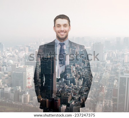 business, people, development and future concept - smiling young buisnessman over transparent city background - stock photo
