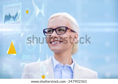 business, people, development and future technology concept - young smiling businesswoman in eyeglasses with virtual screen and charts projection outdoors - stock photo