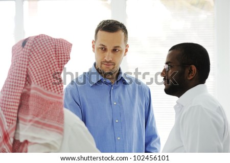 Business people different cultures and races talking - stock photo