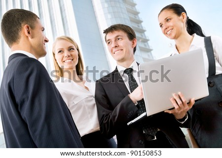 Business people  discuss a new ?????? outside modern office building