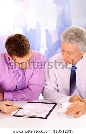 Business people discuss important matters in their office - stock photo