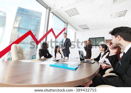 Business people discuss red arrow of income growth at meeting - stock photo