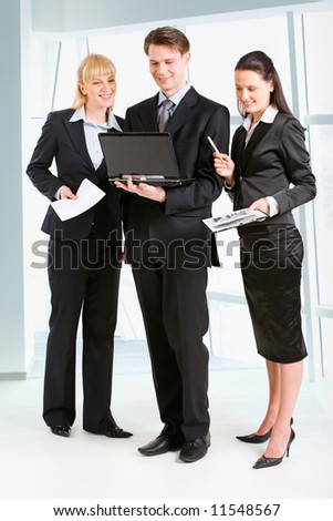 Business people discussing a new plan and standing in the office - stock photo