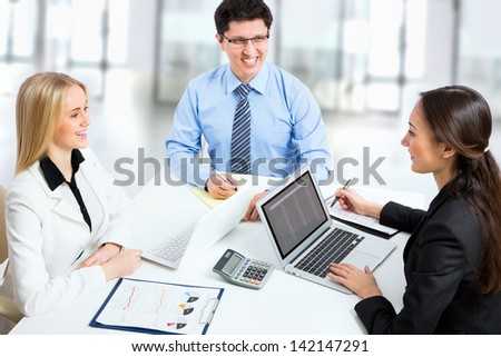 Business people discussing a new project in the office - stock photo