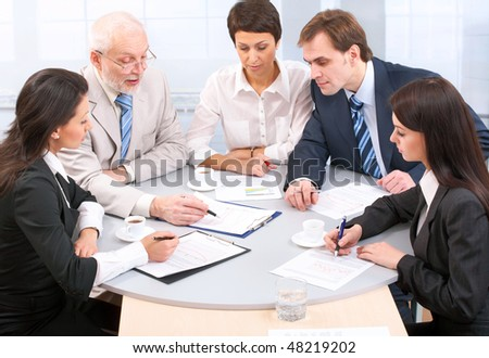 Business people discussing  at office - stock photo