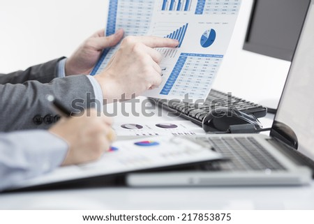 Business people discussing during a meeting on table - stock photo