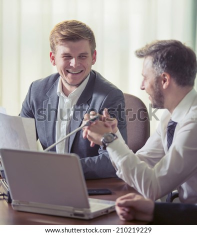 Business people discussing. Everyday setting. Image of two young businessmen at meeting