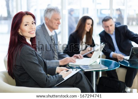 Business people discussing in a meeting. Shallow depth of field. Please see more photos and video ( Business concepts ).  - stock photo