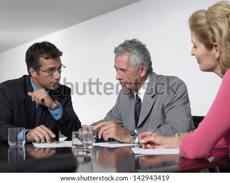 Business people discussing in conference room - stock photo