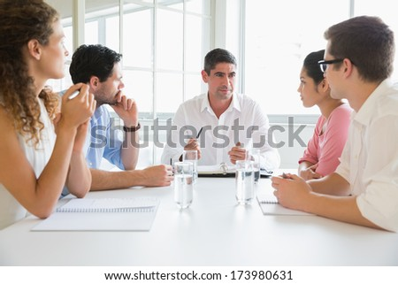 Business people discussing in meeting at conference table in office - stock photo