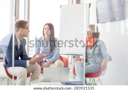 Business people discussing in meeting room - stock photo