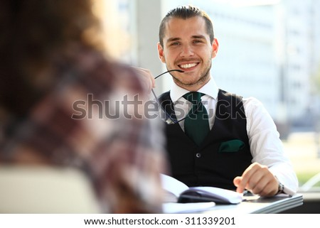 Business people discussing new project with focus on smiling business man  - stock photo