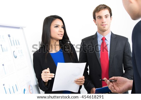 Business people discussing (presenting) work in the office - stock photo