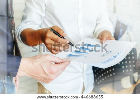 business people discussing the charts and graphs showing the results of their successful teamwork. Business concept. Vintage tone Retro filter effect,soft focus,low light.   - stock photo