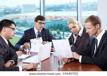 Business people discussing the growth of income at a table in the office - stock photo