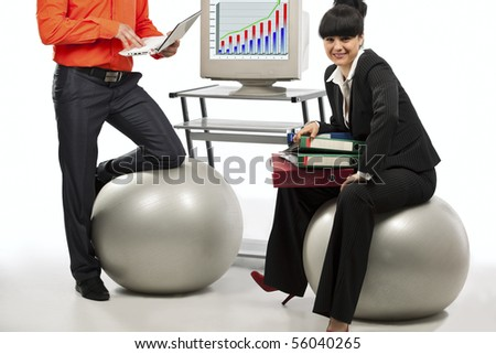 Business people doing exercise with a grey workout ball , over white background. - stock photo