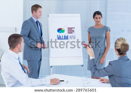 Business people doing statistics presentation in the office