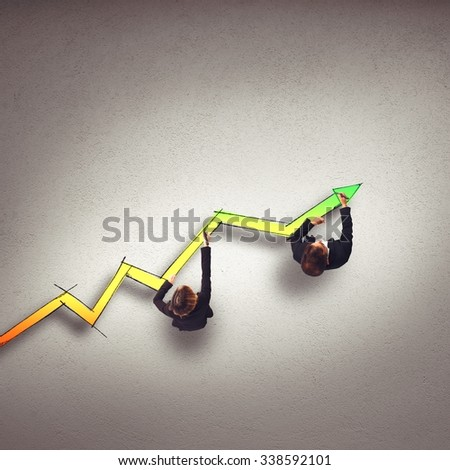 Business people draw a big statistic arrow - stock photo