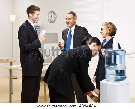 Business people drinking water at water cooler