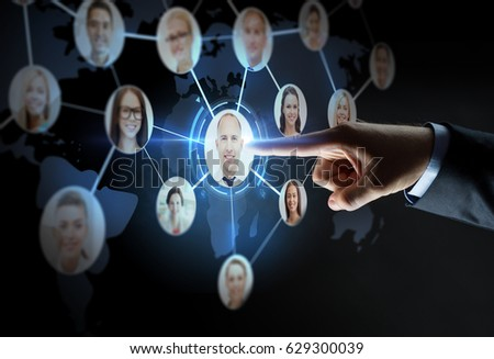 business, people, employment, headhunting and network concept - close up of businessman hand pointing finger to virtual contact projection over black background
