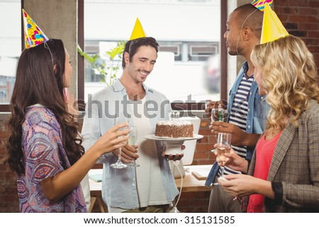 Business people enjoying at birthday party in office - stock photo