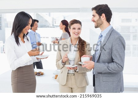 Business people enjoying their drinks while chatting - stock photo