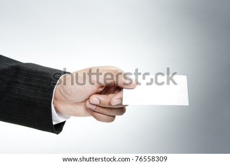 Business people exchanged business cards - stock photo