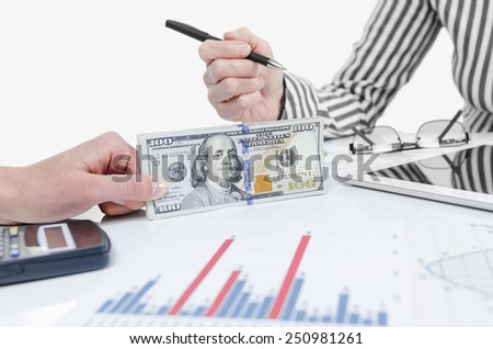 Business people exchanging dollar banknotes. Closeup shot of hands - stock photo