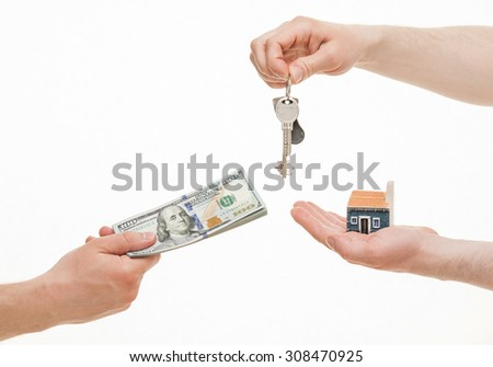 Business people exchanging keys and money, white background - stock photo