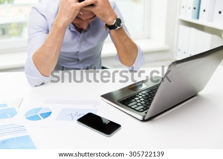 business, people, fail, paperwork and technology concept - businessman with laptop computer and papers working in office - stock photo