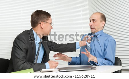 Business people fighting at the desk in office - stock photo