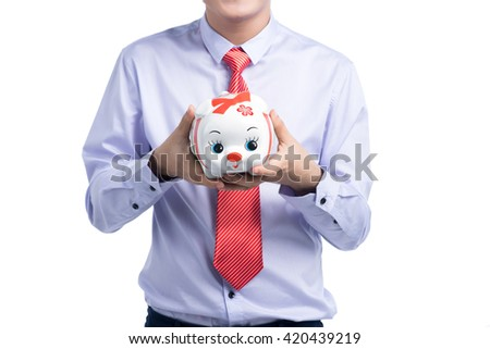 Business, people, finances and money saving concept. Asian businessman holding piggy bank - stock photo
