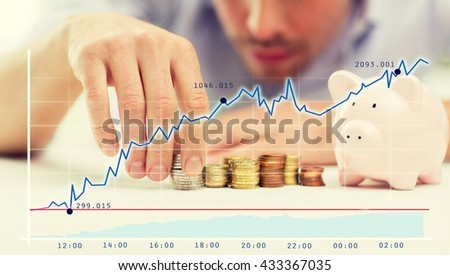 business, people, finances and money saving concept - close up of businessman with piggy bank and coins over growing chart - stock photo