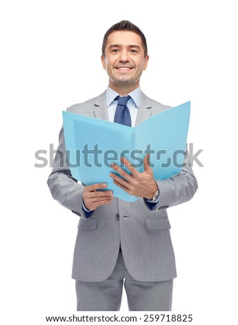 business, people, finances and paper work concept - happy smiling businessman in suit holding open folder - stock photo