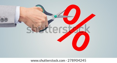 business, people, financial crisis, sale and default concept - close up of businessman hand with scissors cutting percents over gray background - stock photo