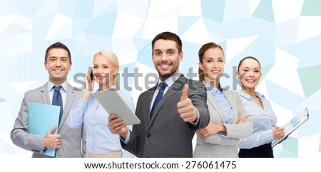 business, people, gesture and office concept - group of smiling businessmen showing thumbs up over blue low poly background - stock photo