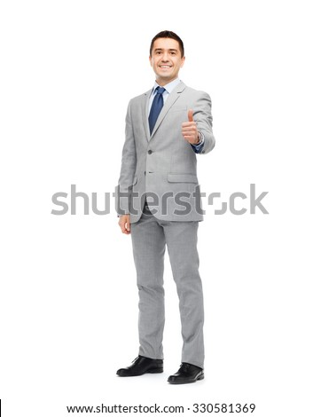 business, people, gesture and success concept - happy smiling businessman in suit showing thumbs up - stock photo