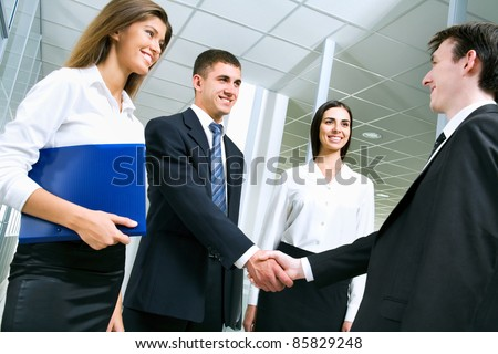 Business people greet each other in the lobby of the office - stock photo