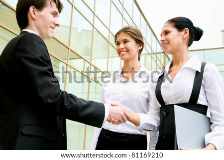 Business people greet each other with a handshake - stock photo