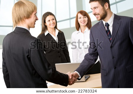 Business people greeting each other before meeting
